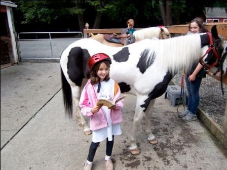"""Eden doing some """"horse back reading""""!"""